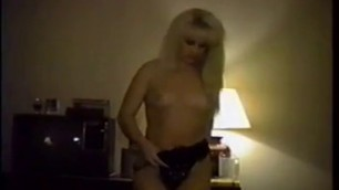 Blonde whore stripping and flaunting her hairy wet pussy